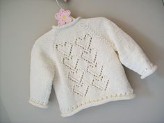 my gauge is correct x at with needles but the cardi is huge cardi width = : it's a french months size, not a months ! pattern needs a lace chart… I drew it. Knitted Cushion Covers, Knitted Cushions, Baby Knitting Patterns Free Newborn, Free Knitting, Knitting Ideas, Cardigan Pattern, Baby Cardigan, Baby Staff, Baby Sweaters