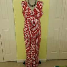 Chico's red & white maxi dress Red & white design maxi dress with knot between breasts.  Dress this up or go casual.  Perfect summer dress.  Chicos  size 2 which is a 12.  Only worn once.  Jacket sold separately here.  Beautiful dress for summer into fall. Chico's Dresses Maxi