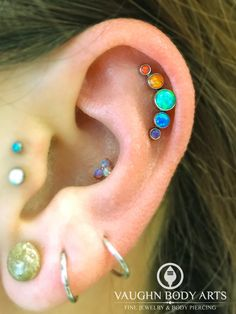 Felicia had us custom order her this @anatometal cluster with a beautiful opal rainbow combination she came up with.  She stopped in today and had her helix pierced by our apprentice Brittney.  We love the look and placement of this piercing!  Thanks so...