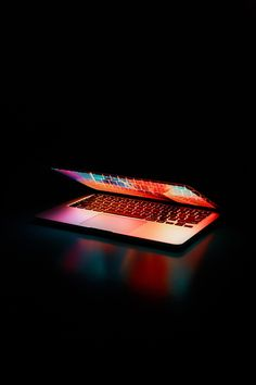 Stunning Semi opened Laptop Computer Turned on on Table art colorful computer contemporary dark design display electronics internet laptop macbook macbook pro technology wireless Best Gaming Laptop, Laptop Computers, Router Wifi, Laptop Repair, Buy Laptop, Best Laptops, Top Laptops, Alienware, Adobe Photoshop Lightroom