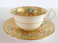 RESERVED FOR S Gold Chintz Enamelled China Tea cup and Saucer