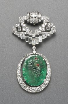 An art deco emerald, diamond and platinum clip brooch, French