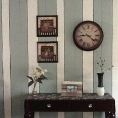 One idea to change wood paneling. Creating vertical stripes and pinstriping the narrow grooves with black paint gives it a more french country look.