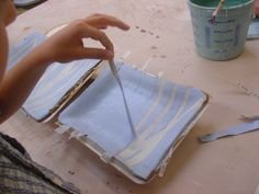 using clay slips and newspaper as stencils