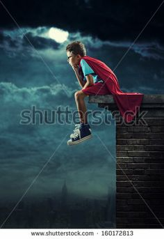 A Young Boy Dreams Of Becoming A Superhero. Stock Photo 160172813 : Shutterstock