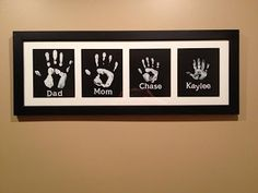 Family Hand-print artworks but with the four dogs paw prints too