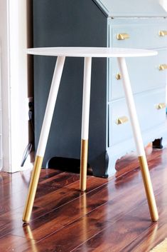 Simple side table DIY with gold dipped legs.