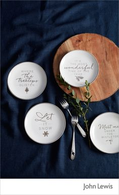 Update your Christmas tableware with the John Lewis Snowshill plates. Featuring four different festive phrases, they are a fun and novel addition to the table. Pair with navy table linen and natural wood, to create a timeless Christmas table.
