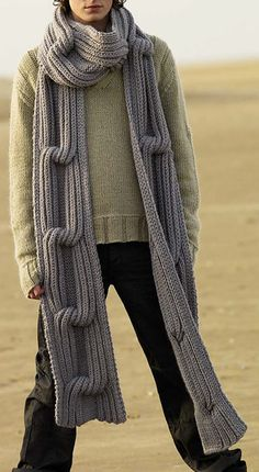 Free Knitting Pattern for Traveller Super Scarf - Designed by Martin Storey for Rowan, this pattern includes long and short versions of this scarf with huge chunky cable. Quick knit in super bulky yarn. Available in English, German, Danish and Swedish