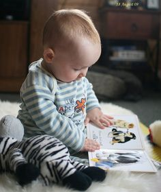 I love pictures of babies with books.