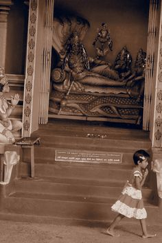 Largest Boadist temple in Matale Sri Lanka.  I sa w this little girl together with her grand ma, who was teaching her how to pray to the Budha. She walked away with her hands folded, the same as the statue left in the picture.