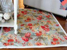 DIY Network has instructions on how to turn home decor fabric into an area rug.