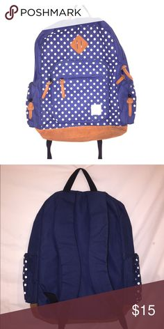 Anonymous Friends Backpack Super spacious blue Backpack with white polka dots and brown accent points. Extra compartment inside for a laptop as well as a small pocket inside. Each side has a zip pocket with a large zip pocket in the front with a smaller one attached. Also has breathable straps for the back! Bags Backpacks