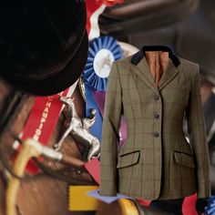Our exclusive Equetech® tweed show jacket in a Green herringbone tweed with staggered Navy & Red over checks. Features flap pockets with concealed zip pockets, rich gold Equetech® jacquard lining, Navyfabric collar and pocket jets and double back vents. #showriders #showhorses #tweedshowjackets #tweed #equestrianwear