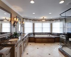 Photo of a traditional bathroom in Columbus with an undermount sink, shaker cabinets, dark wood cabinets, a drop-in tub and beige walls. Description from houzz.com. I searched for this on bing.com/images