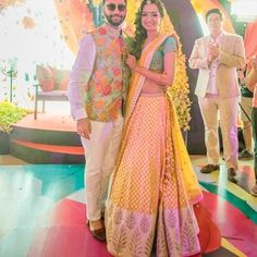 The bride and groom at the Mehendi - Sabyasachi - Anita Dongre