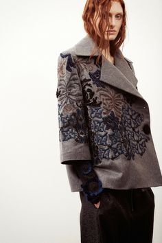 For a jaunt to the wood pile, this big embroidered pea coat over a thick Irish cableknit sweater with sleeves peeking out will do the trick! Sharon Wauchob   Pre-Fall 2014 Collection   Style.com
