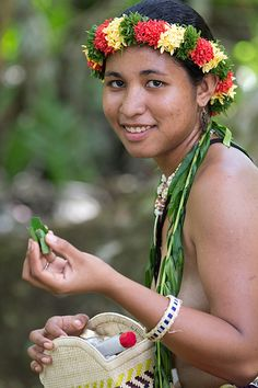 Young girl from Guam rolling a bethel nut