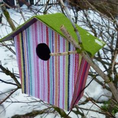 Decorative birdhouses made with cardboard and fabric.