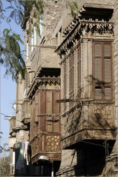 Wooden balconies Cairo- times gone by. Google Image Result for http://img.posterlounge.de/images/wbig/patrick-syder-wooden-balcony-in-old-cairo-82873.jpg