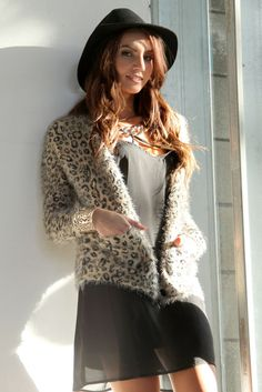 The fluffy knit is totally in!  This warm cardigan is so soft, you'll never want to take it off.  Featuring a leopard print design with button up closure. $59 at Obsezz.com