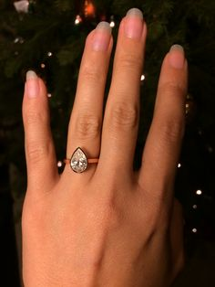 rose gold bezel pear shaped diamond engagement ring