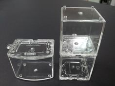 Stackable display cube 4 cm x 4cm x 4cm Stackable curve display 5cm x 4cm x3.5cm Clear non yellowing plastic sealable to contain liquid or as dry display of miniatures.