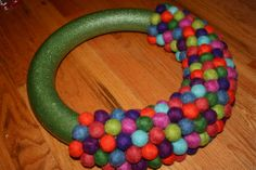 Felt ball wreath.  Using styrofoam wreath & hot glue