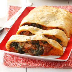 Italian Sausage Calzone Recipe -My teenage daughter and I have been experimenting in the kitchen to re-create some old-time family dishes. This calzone with spinach and sausage is definitely a favorite. Using a refrigerated pizza crust, it's a cinch to prepare one for us or several for a crowd. –Terri Gallagher, King George, Virginia