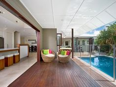 I love how kitchen/living area opens up onto the deck and pool. Would be great for entertaining.