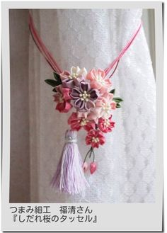 Inspiration for a curtain holder with kanzashi flowers - I really like the colors