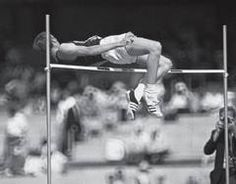 """Dick Fosbury using the """"Fosbury Flop,"""" a then-unorthodox head-first, back-to-the-bar method of high jumping, at the Mexico City Games. He cleared 7 feet 41/4 inches for a gold medal and a world record. He was from Medford, Oregon!"""