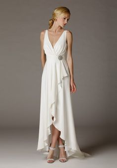 surplice style v neck wedding dress with a low cut back and hi low