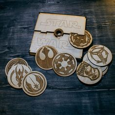Box with set of 12 coasters with emblems of Star Wars theme. Perfect gift for geeks, Star Wars funs, parties etc. Can be used as beer-mats, tea-mat,