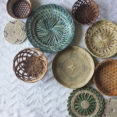 Spruce up your wall with this set of green accented woven baskets. Now listed.
