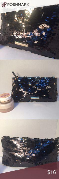 "Victoria's Secret Sequin Makeup Bag Beautiful black sequin makeup bag. Top zip closure. Interior is vinyl-like for easy cleaning. Excellent used condition! Measurements: 10"" L 5"" H 3"" W. Victoria's Secret Bags Cosmetic Bags & Cases"