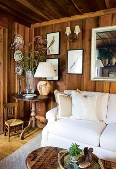 Love this tip explaining how to create a fresh, light look in an interior with dark wood paneling. (Hint: it involves white ;-)
