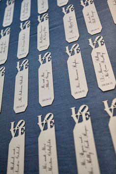TableArt- Wedding- Laser cut LOVE statue book marks combine the couples love of Philadelphia and reading. Each is hand calligraphed and act as the guests escort card . {Venue: Four Seasons Philadelphia | Marie Labbancz}