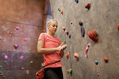 young woman exercising at indoor climbing gym wall by dolgachov. fitness, extreme sport, bouldering, people and healthy lifestyle concept ¨C young woman with chalk bag exercising at i. Indoor Bouldering, Indoor Climbing Gym, Rock Climbing, Sporty Teen, Photos Booth, Womens Wellness, Sports Photos, Galaxy Wallpaper, Extreme Sports