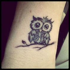 Cute little owl tattoo.