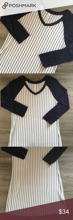 3/4 sleeve baseball dress Striped v-neck baseball mini dress with 3/4 sleeves. Available in S, M and L in black, navy, charcoal and burgundy.                                                                                    Measurements: Small - bust: 15.5 inches, length: 31.5         Medium - bust: 16.5 inches, length: 32.5                               Large - bust: 18 inches, length: 33 Dresses Mini