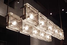 Glass block pendant How about hanging vertically, like a sconce, on each side of the vanity mirror? Along with a couple rows of glass block at the top of the wall. Interior Lighting, Lighting Design, Unique Lighting, Ceiling Lamp, Ceiling Lights, Glass Brick, Restaurant Lighting, Cast Glass, Light Architecture