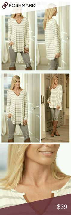 Beyond Basic Striped Tunic In Gray This will be a go to favorite with its classic striped print and a touch of suede along the V neck. Super soft knit with long sleeves, it's perfect paired with leggings or skinny jeans. In gray stripes. Made in the USA. 95% rayon 5% spandex. Small (2/4), Medium (6/8), Large (10/12). Infinity Raine Tops Tunics