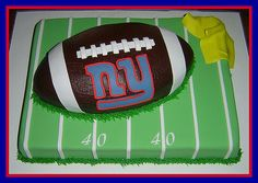 """This cake was for a friend, who's husband was celebrating his 40th birthday with friends and family, which is why I highlighted only  the """"40 yard line""""...The birthday """"boy"""" is a NY Giants fan, hence the logo.  The yellow penalty flag in the upper right corner is simply a """"coverup"""" for not having enough green fondant to cover the """"field"""".  It looked like it needed a touch of color anyway!!!  LOL  The field is an 11 x 15 white cake, buttercream frost..."""