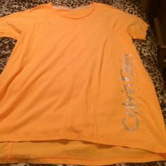 Peach color T-shirt Very comfy everyday peach color t-shirt. Has been washed and hang dry. Calvin Klein Tops Tees - Short Sleeve