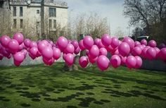 Use golf tees to hold balloons down