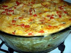 Easy! Seven layer Mexican dip recipe..•1 Can refried beans   •2 Mashed avocados•8 Ounces sour cream•½ Package taco seasoning•Shredded cheddar cheese  •Green 0nions•Black olives•Chopped tomatoes•Tortilla chips