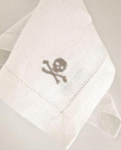 Ralph Lauren linen cocktail napkins embroidered with silver metallic skulls