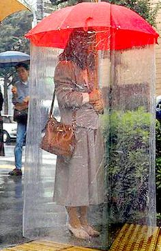 Dumb-inventions.com includes the umbrella rain tube on its list of stupid new products.  Sure, it protects you from the rain, but it won't protect you from getting mocked on the street just for carrying the thing.