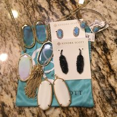 New Arrivals ☺️❤️ Newest pieces listed below:  1) Clear iridescent Rayne 2) White iridescent Rae  3) Ice blue opal Elaine studs  4) Ice blue opal Erica bracelet 5) Clear iridescent Deilys  6) White pearl Deilys 7) Black drusy Frans Kendra Scott Jewelry Earrings